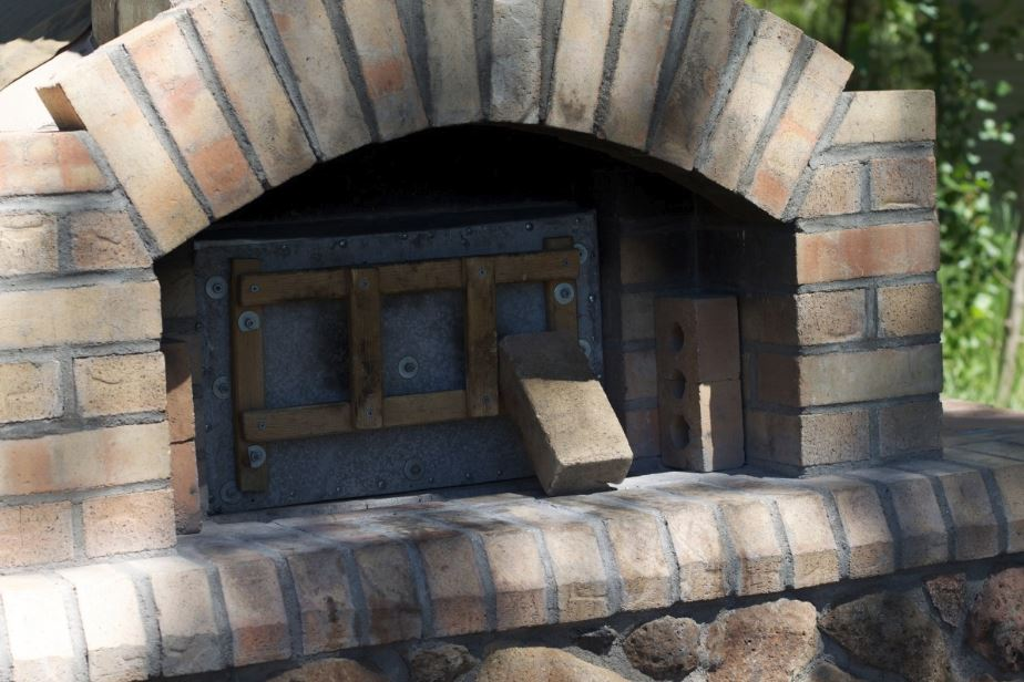 Brick and stone fitted inglenook fireplace