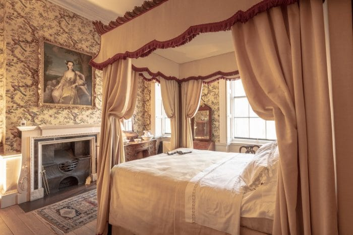 French style bedroom with four poster bed and canopy
