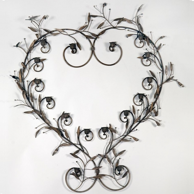 https://www.homesdirect365.co.uk/images/metal-heart-shaped-antique-french-style-candle-holder-p44361-40667_medium.jpg