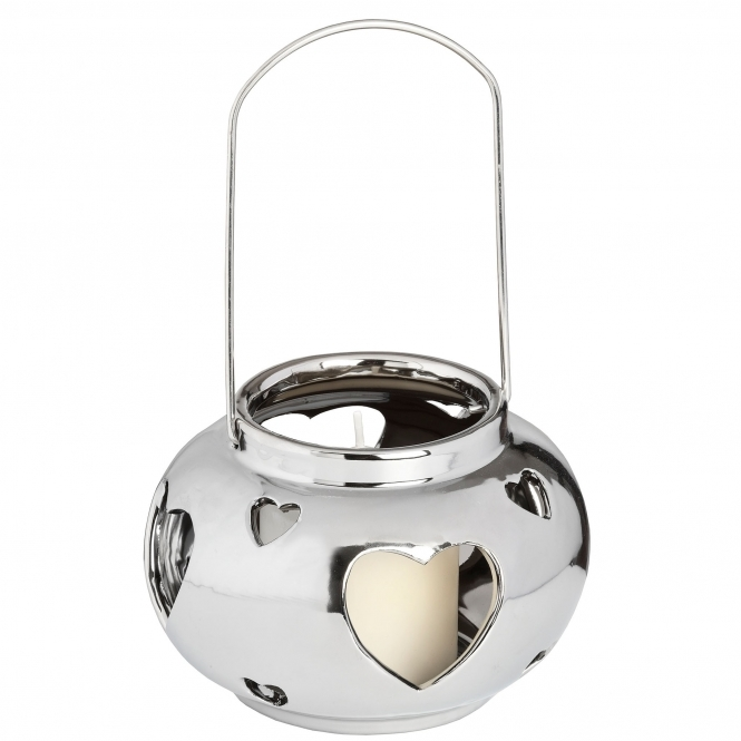 https://www.homesdirect365.co.uk/images/round-heart-silver-candle-holder-p43793-38665_medium.jpg